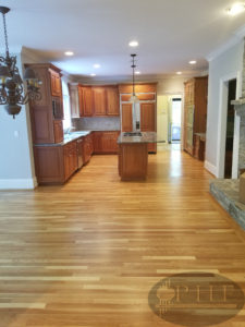 Dustless refinishing of white oak floors with three coats oil base finish satin.